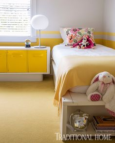 Sunshine yellow reigns in this chic girl's room—a perfect choice for the home's beach location. - Photo: Marco Ricca / Design: Timothy Brown