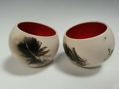 Christine Gittins. Two bowls with feather carbonization and red glazed interiors.