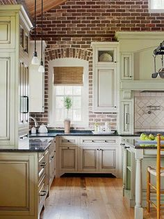 Rustic Traditional Kitchen with brick arch and double-sided stove ...