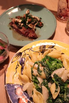 dinner on Mon. 23 Feb. 2015: coquille with rape blossoms & radish by cream sauce, beef steak with mushroom persley sauce, pickled red radish & Komatsuna(: Japanese mustard spinach), red wine