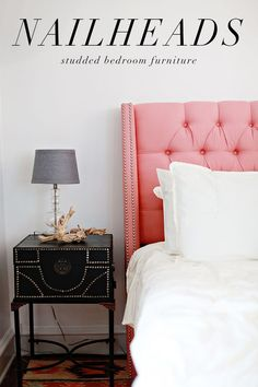 Pink tufted and studded headboard