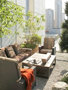 Rooftop Contemporary  Create a high-end modern feel with contemporary furnishings. A gravel patio and simple plantings are the perfect choice for this rooftop space above a modern condominium with great city views.
