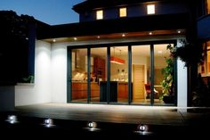 Eco-friendly house extension using 5 panel bi-folding doors Lighting, doors and deck