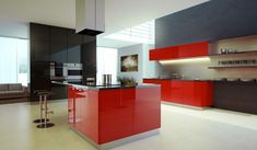 Black kitchen with red island. I've always liked when the island is a pop color