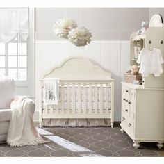 Love the soft colors in this nursery!