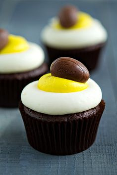 Miniature Cadbury Creme Eggs baked into chocolate cupcakes and topped with buttercream frosting piped to mimic a cracked egg.