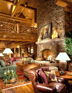Reclaimed barn wood flooring, custom fabricated fireplace doors and one of a kind log hand rail make this living area truly unique! Visit us at frontierloghomes.com