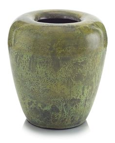 Let your eye follow the simple lines of this vase as it turns in at the lip. The added depth of the mottled green acid patina can only be accomplished over brass.