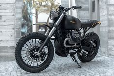 Miami-based Moto Studio created this stunning urban scrambler on Moto Guzzi's platform. Named Braapster, the build is minimal but mean, with all kinds of performance upgrades tucked into that spartan look. The minimalist masterpiece features a