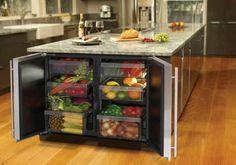 Kitchen island of enormous size with many built-in cupboards for fruits and vegetables The post The modern cooking island in the kitchen & 20 amazing ideas for kitchen design appeared first on Suggestions. Home Decor Kitchen, Diy Kitchen, Kitchen Storage, Kitchen Organization, Organization Ideas, Fridge Storage, Kitchen Layout, Fridge Drawers, Wine Storage
