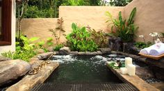 Outdoor spa with waterfall