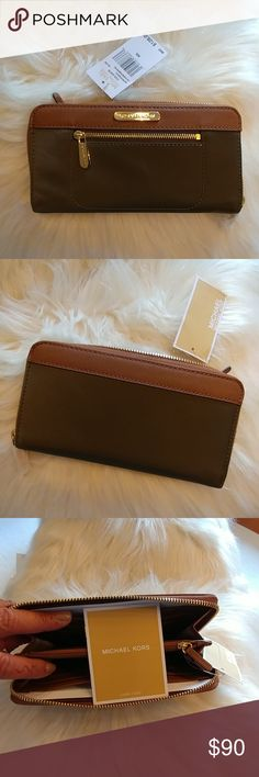 Brand new Michael Kors wallet with tags Brand new Michael Kors wallet in hunter green and brown. Brand new with tags. Michael Kors Bags Wallets