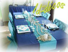 Idées de decoration table en bleu marine et bleu turquoise avec filet de pêche écru id-decos