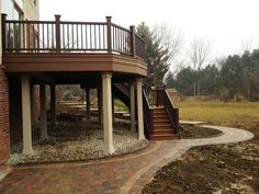 Troy Michigan TimberTech Evolutions composite deck & Oaks Colonnade brick paver patio/walkway
