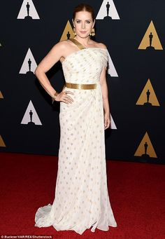 Bold:Amy Adams, 42, glowed in a gold and white polka dot gown featuring ruched detailing and a belted waist