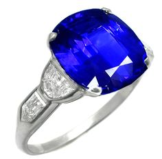 newyorkestatejewelry.com; This is a gorgeous Art Deco platinum Ceylon Sapphire engagement ring. The ring is centered by a fabulous cushion cut Ceylon sapphire that weighs approximately 5.16ct. The sapphire is accentuated by sparkling half moon and bullete cut diamonds that weigh approximately 1ct. The color of the diamonds is F with VS1 clarity. The size of the ring is 6 1/2 but it can be resized.   $24,000