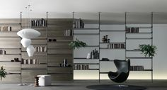 brushed lead structure, shelves in grey transparent glass.