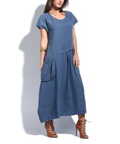 Easy-breezy style is yours with this relaxed-fit maxi dress sporting convenient side pockets for carrying essentials.Size note: This item runs in European sizing. Please refer to the size chart.Shipping note: This item is shipping internationally. Allow extra time for its journey to you.