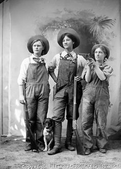 """""""9419-44  Three girls with guns and a dog. Neighborhood teenage girls in Yoncalla, Oregon, """"dress up"""" as hunters for a humorous postcard."""""""