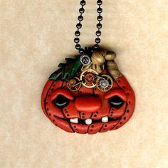 Steampunk Halloween Jack O Lantern Pumpkin Polymer Clay Necklace, via Etsy.