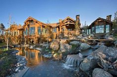 featured posts image for Beautiful rustic mountain retreat set amidst the grandeur of the Rocky Mountains House With Porch, House In The Woods, Cozy House, Dream Home Design, My Dream Home, Dream Big, Rocky Mountains, Magic House, Building A Porch