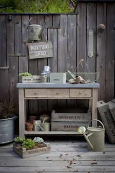 Garden Trading Aldsworth potting table £240, Wooden sign £12, Colworth herb box £22, Wooden seed tray £10, Large and small seed box in clay ...
