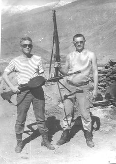 Russian soldiers are holding the spoils of war: the DP light machinegun and the British No.1MkIII rifle (or a locally made copy). Afghanistan, 1980's