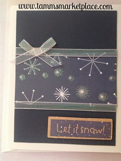 "Handmade glittered ""Let It Snow"" card with blue winter type papers and ribbon accents, will send a winter lover on your list a snowman that's holding a Let It Snow sign next to another message of Just"