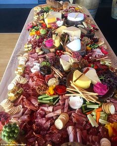 Masterchef star creates a masterpiece of cheese, meat, dips and breads #dailymail