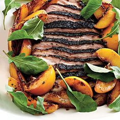 EntertainingEntrées | Roasted Pork Belly with Late Harvest-Peaches and Arugula | SouthernLiving.com