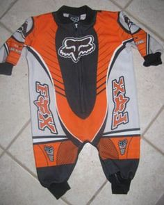 Fox racing onesie , my baby will have a blue one to match his daddy's racing gear (: