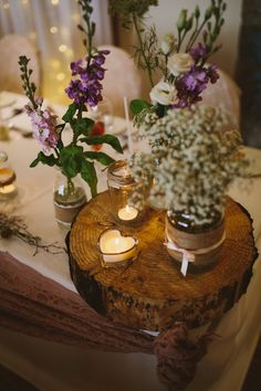 Log Jar Flowers Hessian Ribbon Centrepiece Decor Candles Floral Rustic Country Barn Wedding http://www.allymphotography.com/