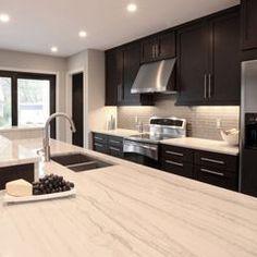quartzite countertops, cherry cabinets, grey backsplash