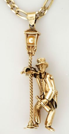 9ct Yellow Gold Victorian Man & Lamppost Pendent with a Pearl & a Figaro Chain    Morbid price but beautiful