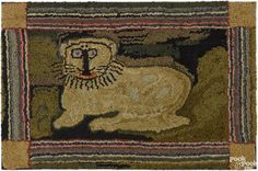 American hooked rug, early 20th c., with a lion, 26'' x 40 1/2''.