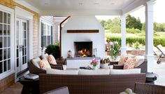 covered porch with fireplace.