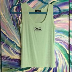 Dolce Gabbana Stretch Tank SIZE: Medium Almost mint condition. See one tiny pick lower right front of tank. Otherwise perfect. Price reflects this. Please see picture. Icy mint green. Delicious to wear. Super sexy. Dolce & Gabbana Tops Tank Tops