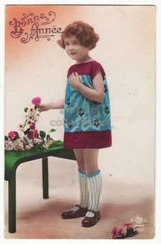 Little girl in colorful dress, ca 1910s
