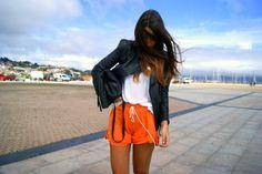 black leather jacket and orange sweat shorts?