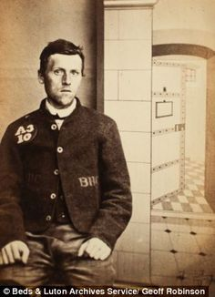 James Knapton, 22-year-old miner, sentenced to 6 yrs for setting fire to a stack of oats. Photographed in front of a fake prison back-drop showing an open cell.