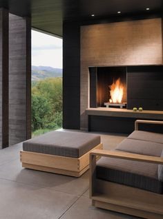 Asymmetrical #fireplace wall complements the spectacular view.