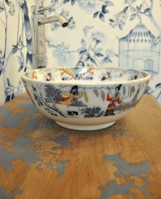 asian inspired vessel sinks | Painted vessel sink mixed with wallpaper and worn vanity top. At Mayme ...