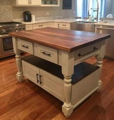 Butcher Block Island top is made from solid American walnut. The base is painted in a Milk Paint finish.