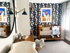 bright and bold mid century modern MCM inspired nursery with black and white wallpaper and colorful accents #nurserydecor #nurseryideas #babynursery #nursery