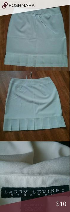 White skirt! White skirt in Perfect condition! NEVER worn! It has a Small ribbon which adds a nice detail! ?NO stains ? Smoke and Pet free ?63% Polyester,  33% Rayon, 3% Spandex ?stretchy according to the tag! ?If you want more pictures pleass let me know! Larry Levine Skirts