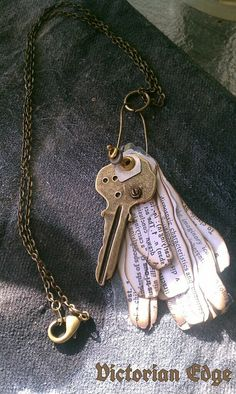 Key and burned paper necklace.