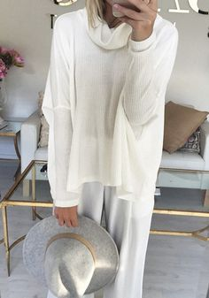 Be cuddle buddies with this adorable cowl neck slit back top.