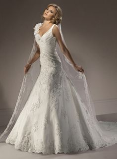 Maggie Sottero Florencia wedding dress. I LOVE the two different shoulders, so, so pretty.