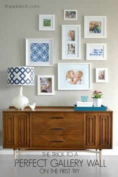 A Perfect Gallery Wall...on the first attempt | No more poking a zillion holes in the wall.  Love this system and that tool!