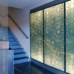 Architectural fabric laminates incorporate a selection of fabrics within glass layers. The beauty, colour and texture of delicate cloth and textiles or printed fabrics combined with structural glass enable bespoke solutions for office screens, doors, lifts and lobbies, interior and exterior facades and wall cladding. Image: bespoke fabric laminate bar front. #architecture #kilnformedglass #architecturalglass #decorativeglass #frostedglass #etchedglass